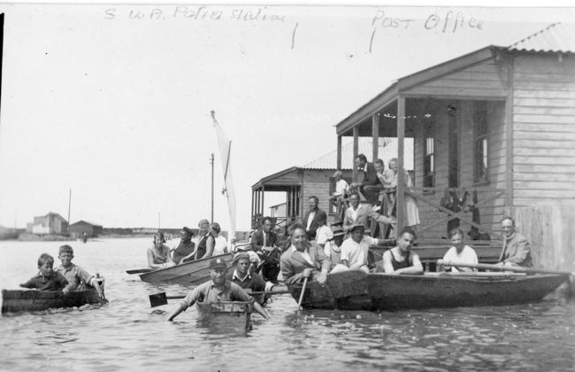 Floods in Walvis Bay, 1934. People in boats on what was streets